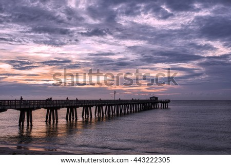 Dawn over the fishing pier - stock photo
