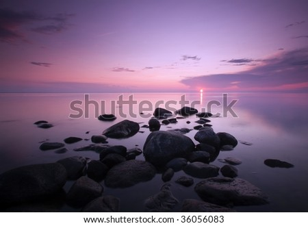 Dawn over the ocean. - stock photo