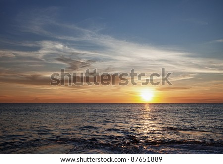 Dawn over the tropical ocean -a landscape - stock photo