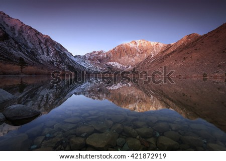 Dawn reflection at Convict Lake in the Eastern Sierra mountains, California, USA. - stock photo