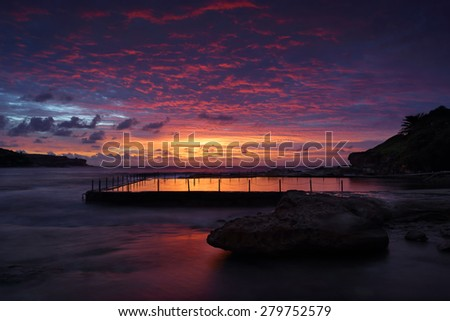 Dawn skies over Malabar Rock Pool and Long Bay, Sydney Australia - stock photo