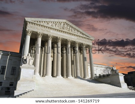 Dawn sky over the United States Supreme Court building in Washington DC. - stock photo