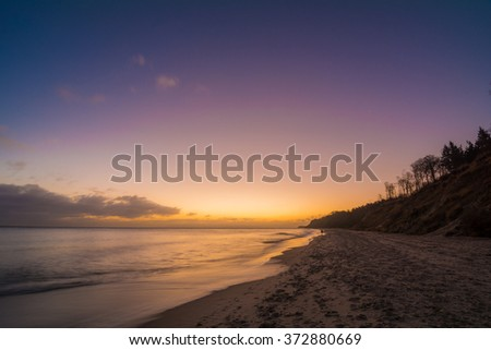 dawning on the Baltic Sea of Usedom in Germany - stock photo