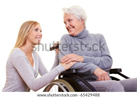 Day care for an elderly woman in a wheelchair - stock photo