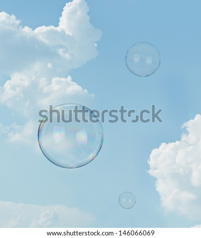 Day dreaming. Two floating soap bubbles against blue sky with copy space - stock photo