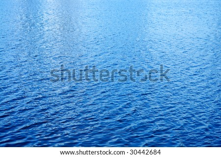 Day light reflected on the water surface - stock photo