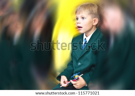 Day of knowledge. Surprised first grade boy - stock photo