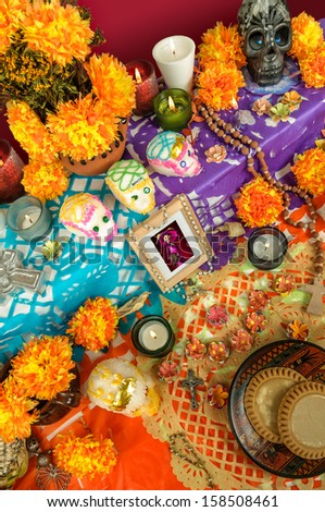 Day of the dead altar with catrina, sugar skulls, cempasuchil flowers and candles - stock photo