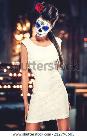 Day of the dead girl with sugar skull makeup   - stock photo