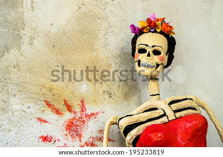 Day of the dead. Traditional mexican catrina skeleton on old wall - stock photo