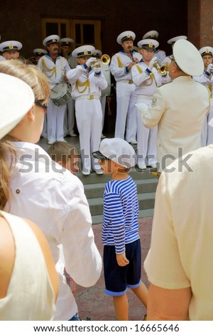 Day of the Navy. July 27, 2008. The city of Sevastopol. Ukraine. Plays door music orchestra. People stand and listen. Children played nearby.