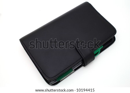 day planner over a white surface - stock photo