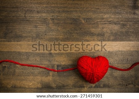 Day. Red ribbon tape and hearts on wooden background. - stock photo
