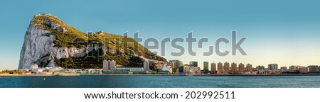 Day view of Gibraltar. Gibraltar is a British Overseas Territory located on the southern end of the Iberian Peninsula at the entrance of the Mediterranean Sea - stock photo