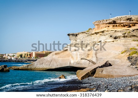 Day view of La Caleta, is a small quiet fishing village and resort. Tenerife, Canary Islands. Spain - stock photo