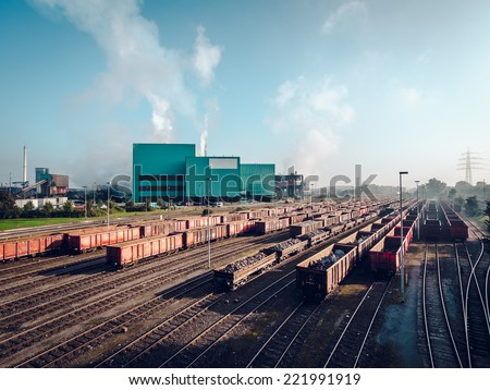 Day view of steel mill - stock photo