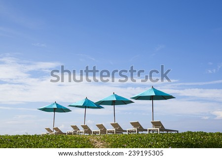 Daybeds on the Beach - stock photo