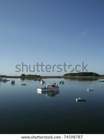 Daybreak at serene fishing harbor in Maine - stock photo