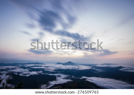 daybreak scene with mountain and movement cloudy at Pha Tang, Chiangrai, Thailand - stock photo