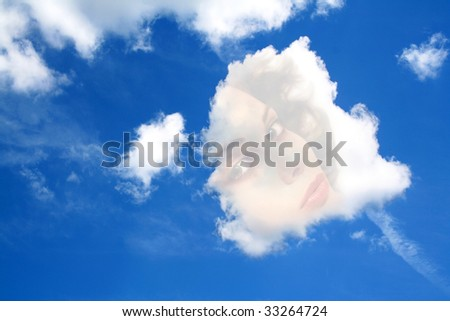 daydream, face of a beautiful woman in a cloud - stock photo
