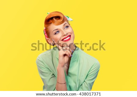 Daydreaming. Closeup red head young woman pretty smiling pinup girl green button shirt  dreaming about love career money looking up retro vintage 50's hairstyle. Body language Positive emotion feeling - stock photo