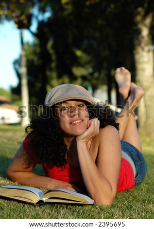 Daydreaming in the park - stock photo