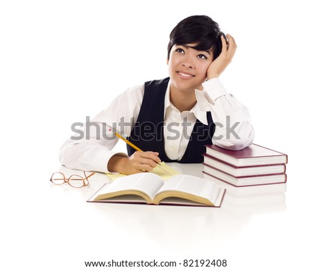 Daydreaming Mixed Race Young Adult Female At White Table with Books Looking Up and Away Isolated on a White Background.
