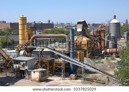 Daylight shot of a small cement factory kilns for costruction building materials, clear sky summer noon photo