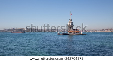 Daylight view of Maiden's Tower with boats in Istanbul, lighthouse. - stock photo