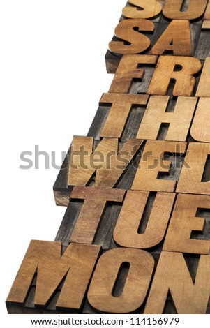 days of week abstract - isolated text in vintage letterpress wood type printing blocks - stock photo