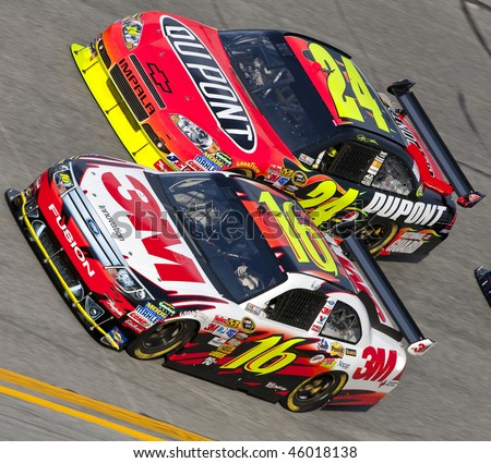 DAYTONA BEACH, FL - FEB 4: Greg Biffle and Jeff Gordon trade lanes during a practice session for the Bud Shootout event at the Daytona International Speedway Feb 4, 2010 in Daytona Beach, FL - stock photo