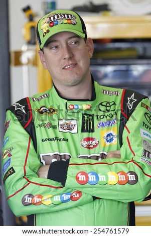 Daytona Beach, FL - Feb 14, 2015:  Kyle Busch (18) talks to his crew during a practice session for the Daytona 500 at Daytona International Speedway in Daytona Beach, FL.