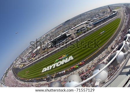 DAYTONA BEACH, FL - FEB 19:  The NASCAR Nationwide Series teams take to the track for the DRIVE4COPD 300 race at the Daytona International Speedway in Daytona Beach, FL on Feb 19, 2011. - stock photo