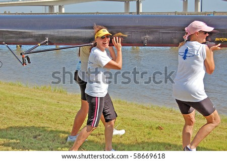 "DAYTONA BEACH, FL - JULY 24:  A novice woman rower emotes pure joy after finishing her first race at the  ""Halifax Rowing Association's Summer Regatta 2010"" on July 24, 2010 in Daytona Beach, Florida."