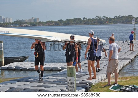 "DAYTONA BEACH, FL - JULY 24:  The men's quad team looks pleased after their race at  the ""Halifax Rowing Association's Summer Regatta 2010"" on July 24, 2010 in Daytona Beach, Florida. - stock photo"