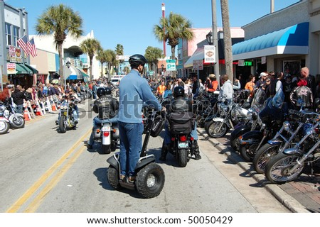 "DAYTONA BEACH, FL - MARCH 6:  A lone Segway glides down Main Street amid the sea of bikers in town for ""Bike Week 2010"" in Daytona Beach, Florida."