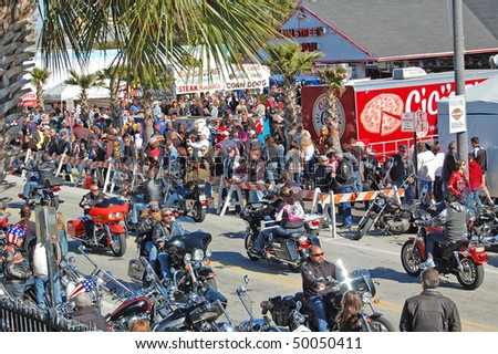 "DAYTONA BEACH, FL - MARCH 6:  Bikers cruise Main Street during ""Bike Week 2010"" in Daytona Beach, Florida."