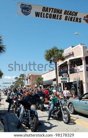 "DAYTONA BEACH, FL - MARCH 17: Bikers cruise Main Street during ""Bike Week 2012"" in Daytona Beach, Florida. March 17, 2012 - stock photo"
