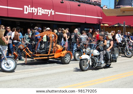 "DAYTONA BEACH, FL - MARCH 17:  Customized motorcycles line Main Street amid the sea of bikers in town for ""Bike Week 2012"" in Daytona Beach, Florida. March 17, 2012"