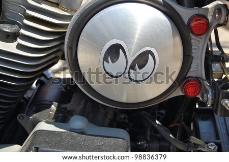 "DAYTONA BEACH, FL - MARCH 17:  Customized motorcycles line Main Street during ""Bike Week 2012"" in Daytona Beach, Florida. - stock photo"