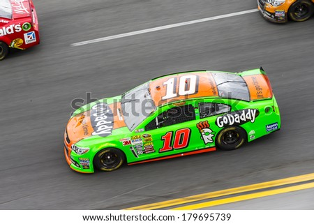 Daytona Beach, NC - Feb 23, 2014:  Danica Patrick (10) brings her race car through the turns during the Daytona 500 race at the Daytona International Speedway in Daytona Beach, NC. - stock photo