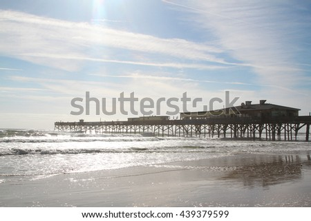 Daytona beach on Atlantic Ocean with pier and boardwalk - stock photo