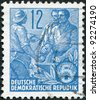 DDR - CIRCA 1953: A stamp printed in DDR, shown Worker, peasant and intellectual, circa 1953 - stock photo