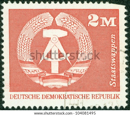 DDR- CIRCA 1975: A stamp printed in DDR shows Emblem of the DDR, circa 1975