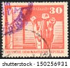 DDR - CIRCA 1973: A stamp printed in DDR  shows  Workers' Memorial, Halle, circa 1973 - stock photo