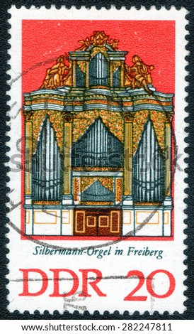 "DDR - CIRCA 1970 A stamp printed in the DDRshows a series of images ""ancient musical organs"", circa 1970.      - stock photo"