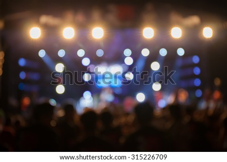 De-focus music performance concert with beautiful bokeh spotlight. - stock photo