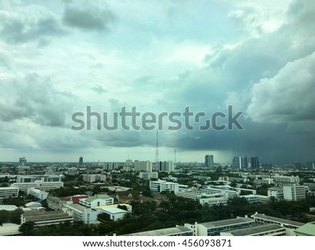 De-focus The City is overcast and the rain is coming, City in darkness. - stock photo