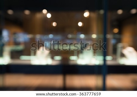 De focused/Blur image of boutique window with dressed mannequins. Boutique display window .  - stock photo