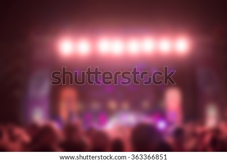 De-focused / blurred concert crowd enjoying the music. - stock photo